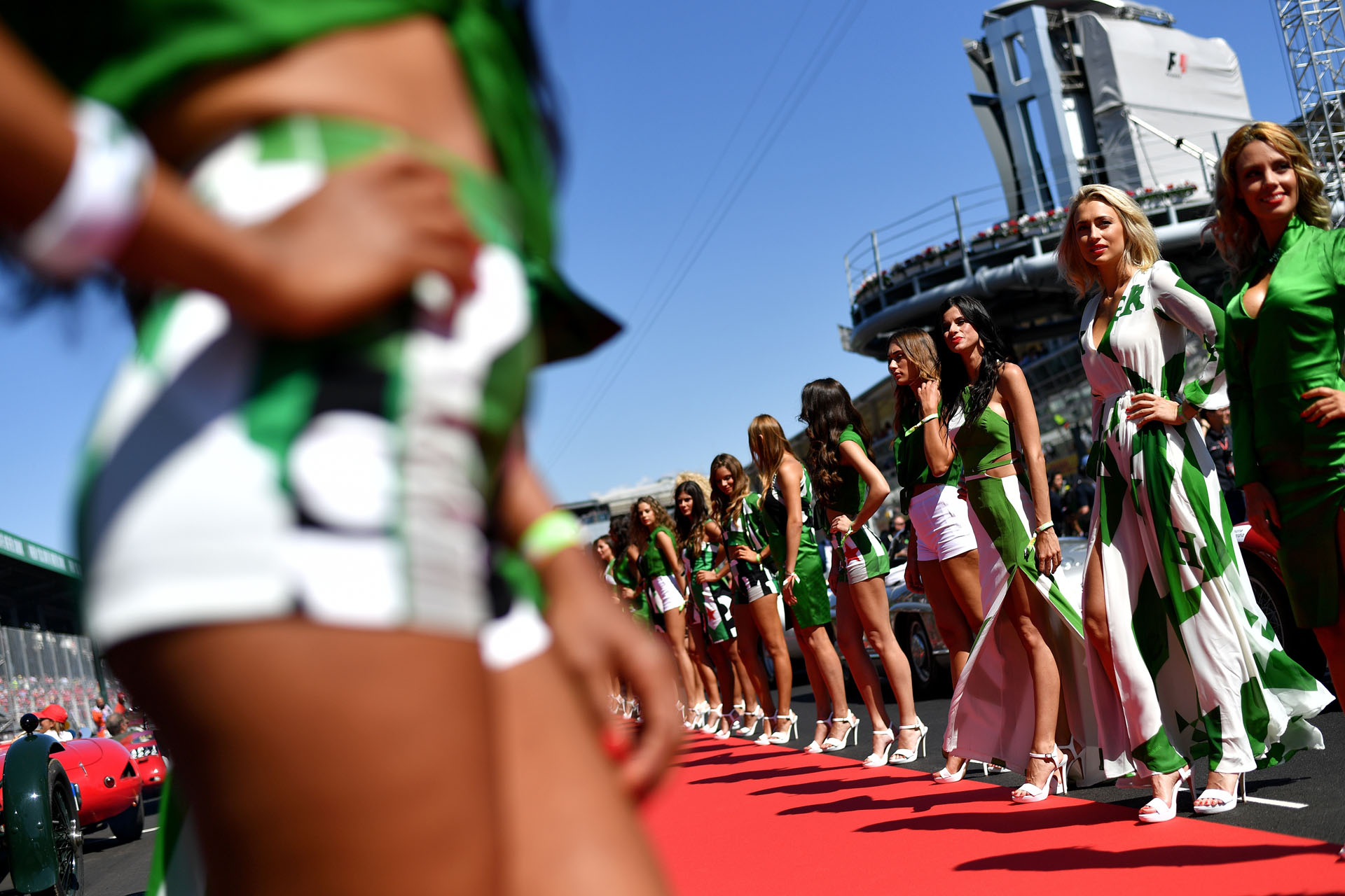Grid girls line up for the pit lane walk ahead of the Italian Formula One Grand Prix at the Autodromo Nazionale circuit in Monza on September 3, 2017. / AFP PHOTO / ANDREJ ISAKOVIC