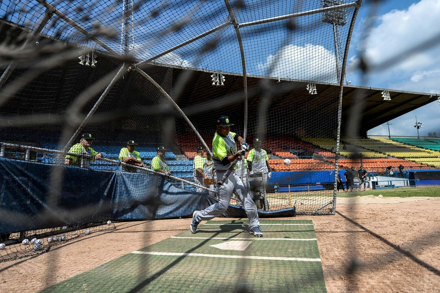 Players of the Venezuelan baseball team Leones del Caracas attend a training session at the Universitario stadium in Caracas, on September 18, 2017. While baseball is Venezuela's national sport, some fans are angry that the government, given the severity of the economic crisis and the political tension, will spend nearly ten million dollars on organizing the upcoming Winter League rather than on imports of food and medicine. / AFP PHOTO / FEDERICO PARRA