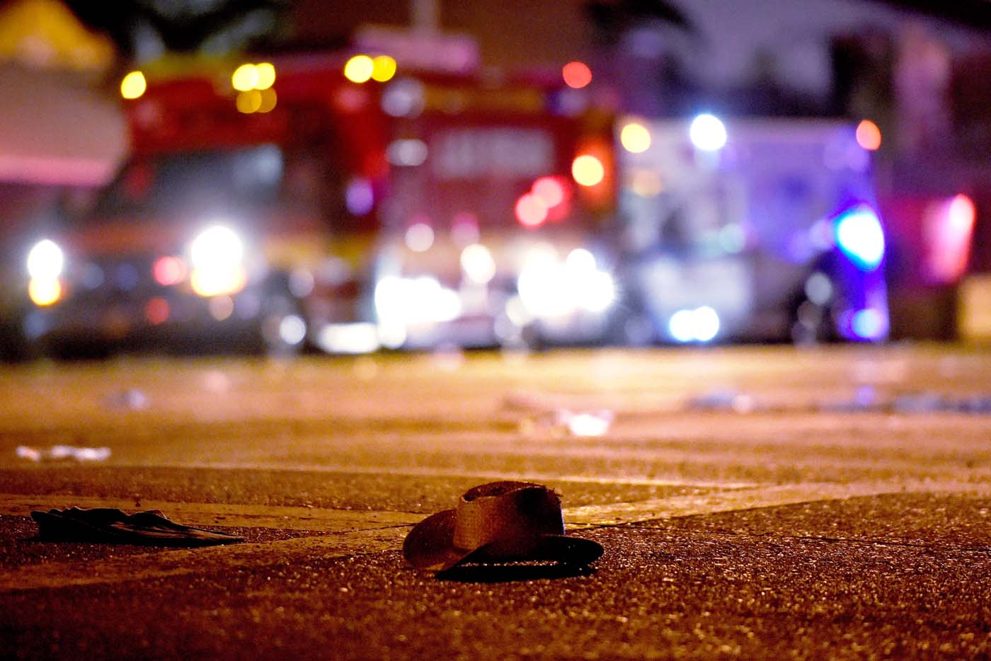 LAS VEGAS, NV - OCTOBER 02: A cowboy hat lays in the street after shots were fired near a country music festival on October 1, 2017 in Las Vegas, Nevada. A gunman has opened fire on a music festival in Las Vegas, leaving at least 20 people dead and more than 100 injured. Police have confirmed that one suspect has been shot. The investigation is ongoing. David Becker/Getty Images/AFP