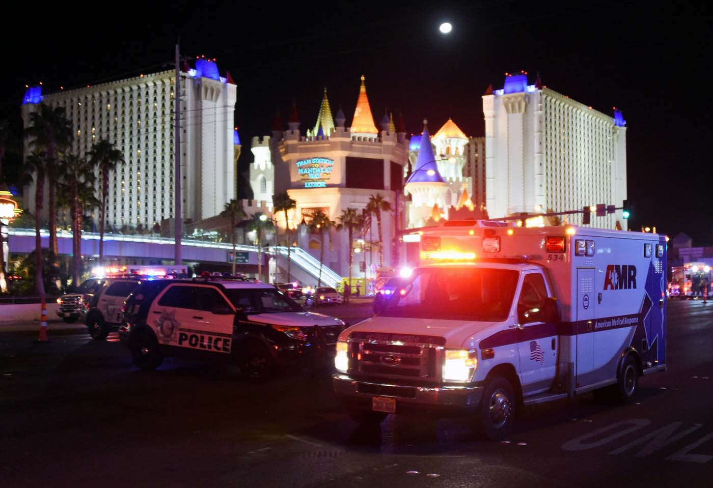 LAS VEGAS, NV - OCTOBER 02: An ambulance leaves the intersection of Las Vegas Boulevard and Tropicana Ave. after a mass shooting at a country music festival nearby on October 2, 2017 in Las Vegas, Nevada. A gunman has opened fire on a music festival in Las Vegas, leaving at least 20 people dead and more than 100 injured. Police have confirmed that one suspect has been shot. The investigation is ongoing. Ethan Miller/Getty Images/AFP