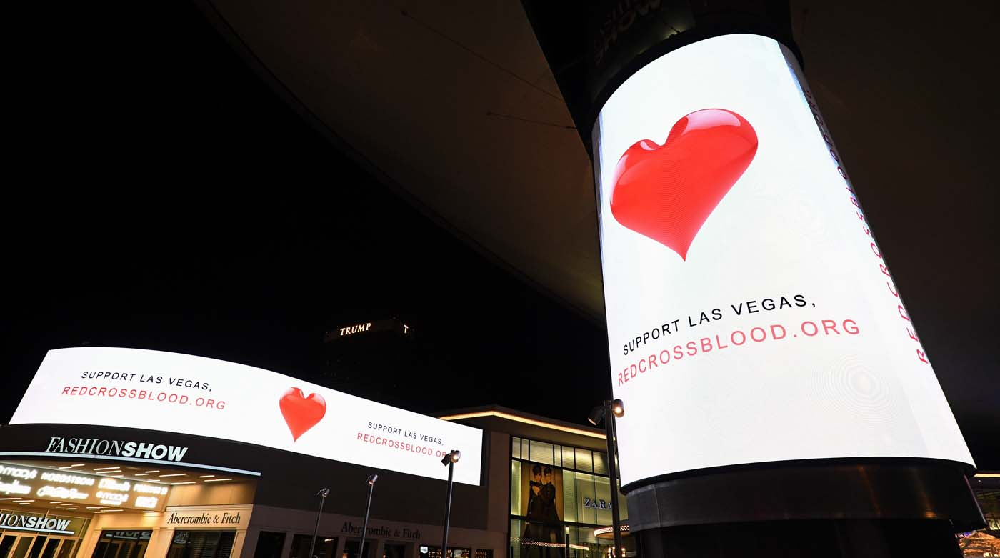 LAS VEGAS, NV - OCTOBER 03: Electronic signs outside the Fashion Show mall on the Las Vegas Strip direct people to support Las Vegas by giving blood to the Red Cross in response to Sunday night's mass shooting at a music festival on October 3, 2017 in Las Vegas, Nevada. Late Sunday night, a lone gunman killed at least 59 people and injured more than 500 after he opened fire on a large crowd at the Route 91 Harvest country music festival. The massacre is one of the deadliest mass shooting events in U.S. history. Ethan Miller/Getty Images/AFP