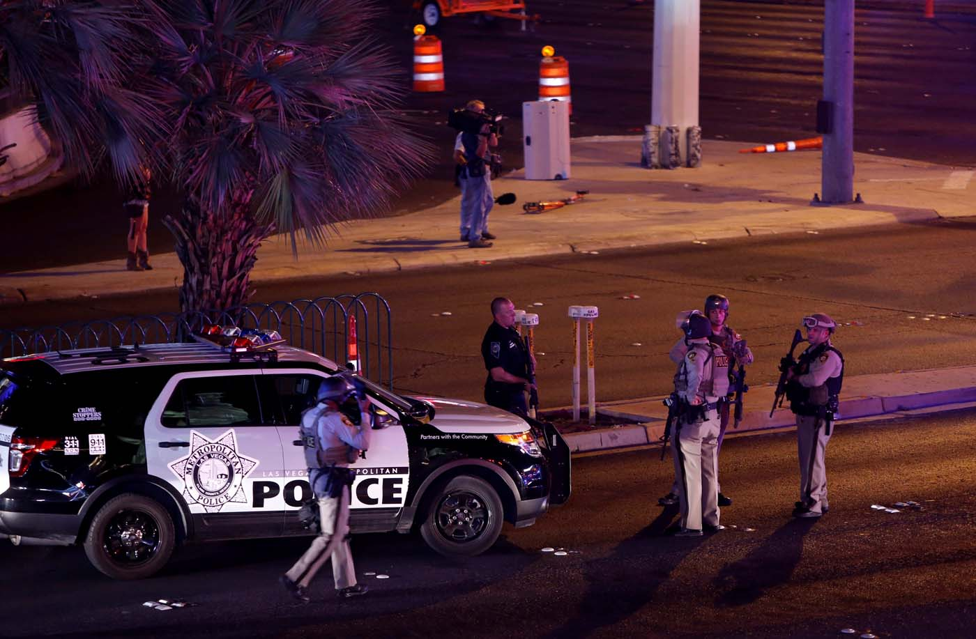 Las Vegas Metro Police officers gather near the intersection of Tropicana Avenue and Las Vegas Boulevard South after a mass shooting at a music festival on the Las Vegas Strip in Las Vegas, Nevada, U.S. early October 2, 2017. REUTERS/Las Vegas Sun/Steve Marcus