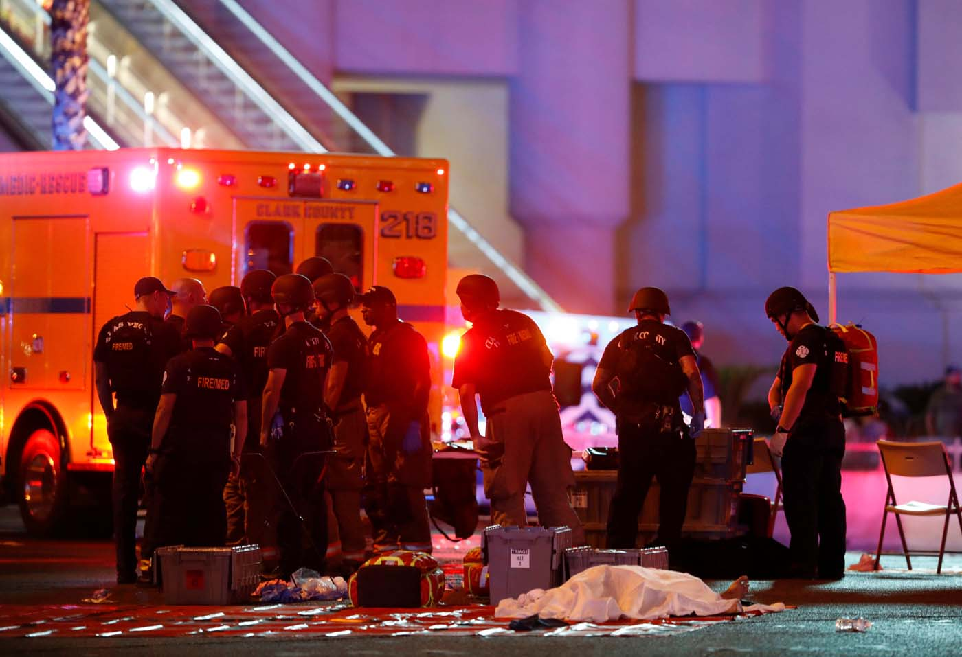 ATTENTION EDITORS - VISUAL COVERAGE OF SCENES OF INJURY OR DEATH A body is covered with a sheet in the intersection of Tropicana Avenue and Las Vegas Boulevard South after a mass shooting at a music festival on the Las Vegas Strip in Las Vegas, Nevada, U.S. October 1, 2017. REUTERS/Las Vegas Sun/Steve Marcus TPX IMAGES OF THE DAY