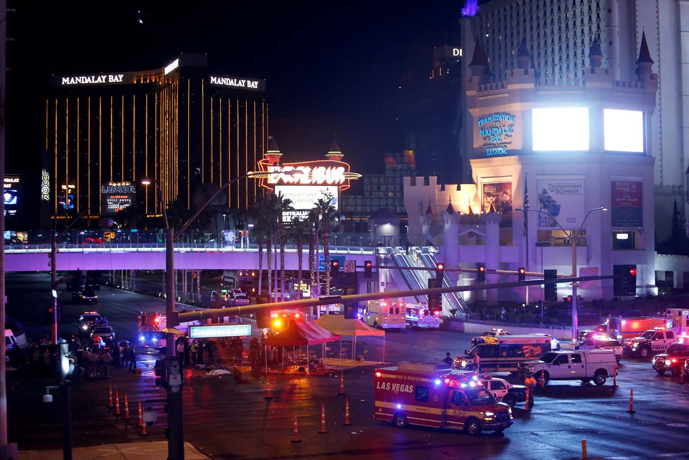 Las Vegas Metro Police and medical workers stage in the intersection of Tropicana Avenue and Las Vegas Boulevard South after a mass shooting at a music festival on the Las Vegas Strip in Las Vegas, Nevada, U.S. October 1, 2017. REUTERS/Las Vegas Sun/Steve Marcus TPX IMAGES OF THE DAY