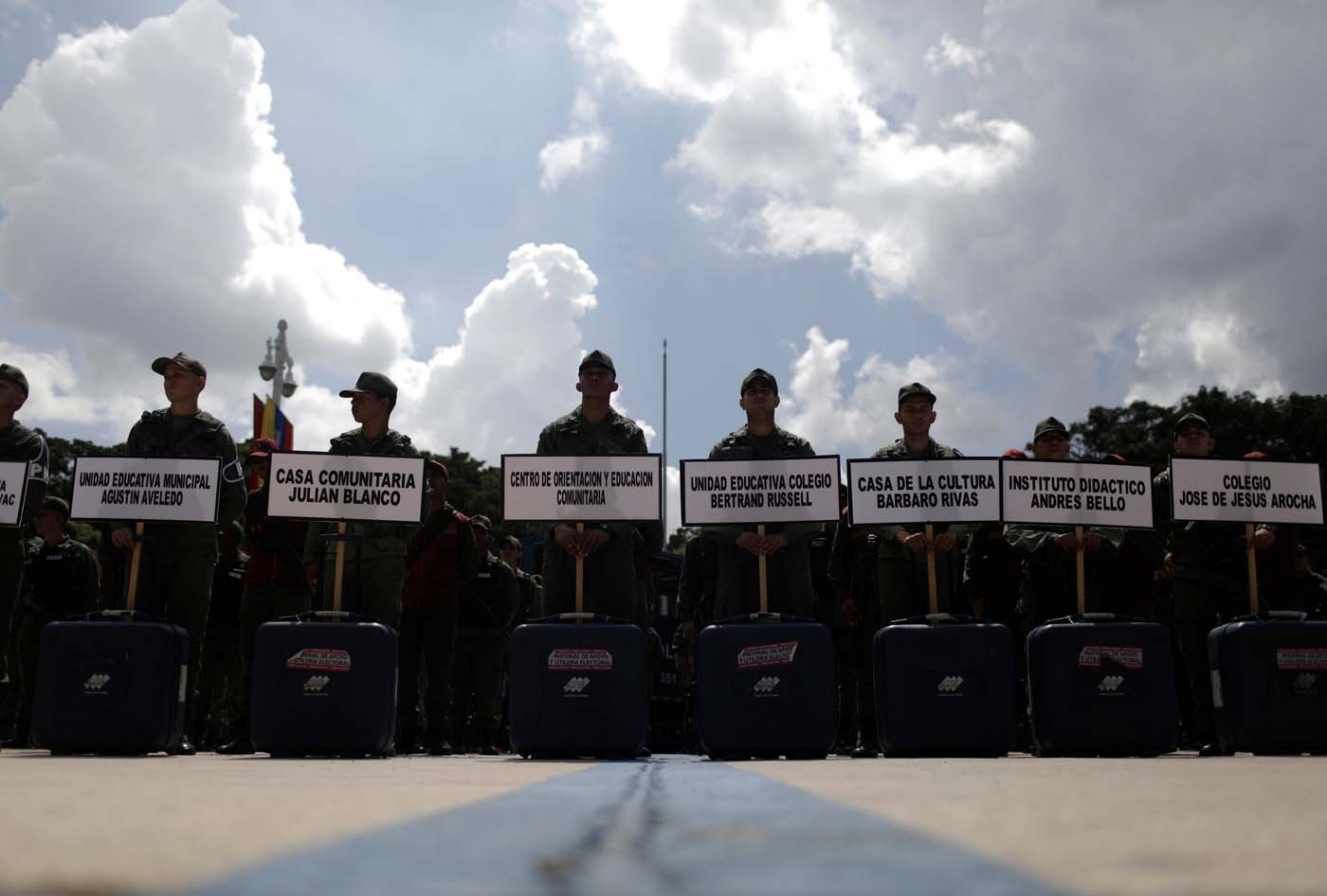 Venezuela's soldiers stand with cases of voting materials during a ceremony ahead of the regional elections which will be held on October 15, in Caracas, Venezuela, October 9, 2017.  REUTERS/Ricardo Moraes