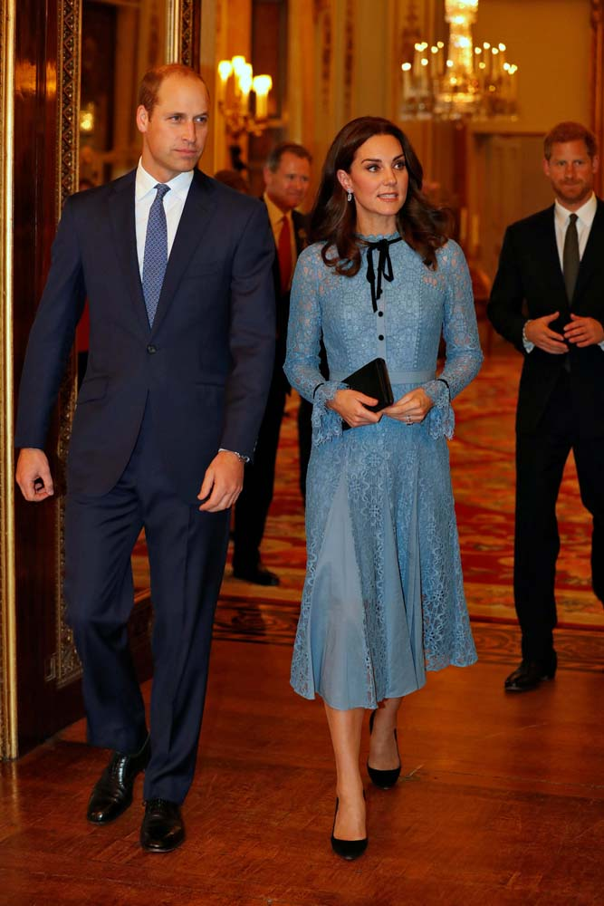 Britain's Prince William, Duke of Cambridge, Catherine Duchess of Cambridge and Prince Harry celebrate World Mental Health Day at Buckingham Palace in London, Britain, October 10, 2017. REUTERS/ Heathcliff O'Malley/Pool