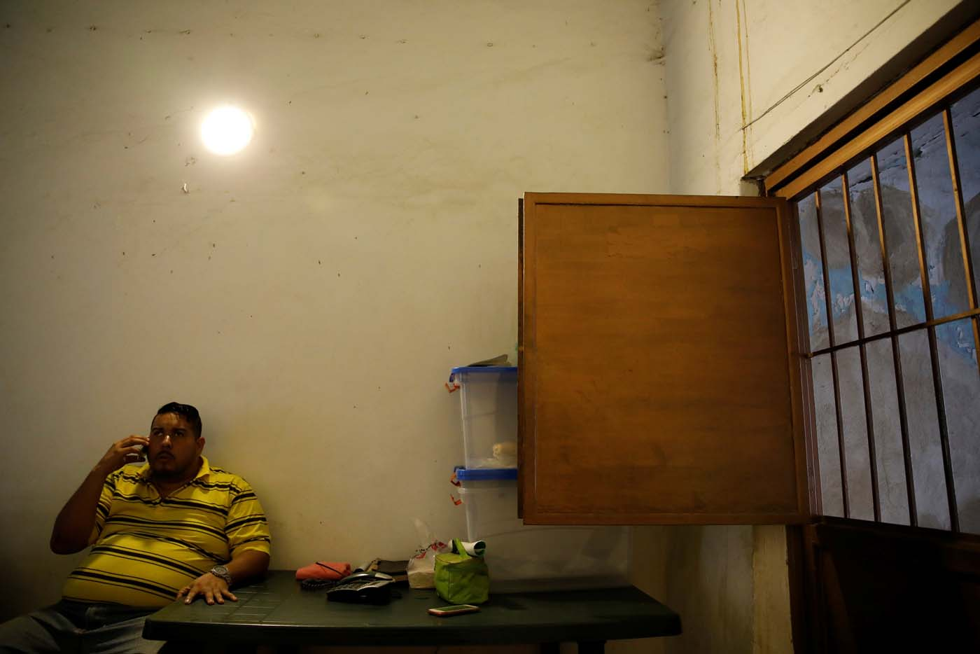 Medical equipment repairman Leandro Colmenares speaks by phone at his house in Caracas, Venezuela October 3, 2017. Picture taken October 3, 2017. REUTERS/Carlos Garcia Rawlins