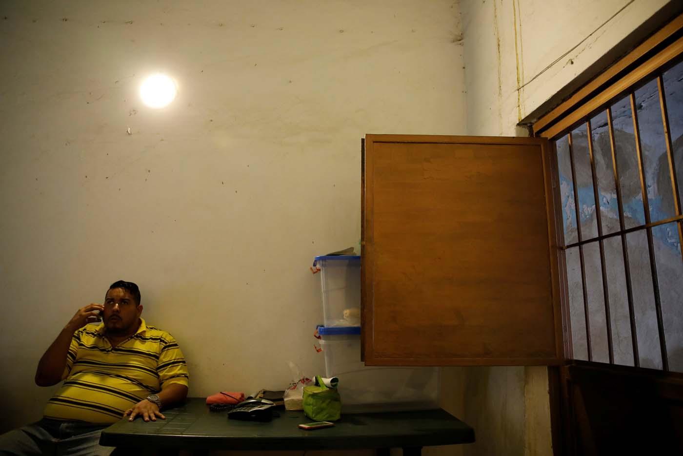 Medical equipment repairman Leandro Colmenares speaks by phone at his house in Caracas, Venezuela October 3, 2017. Picture taken October 3, 2017. REUTERS/Carlos Garcia Rawlins