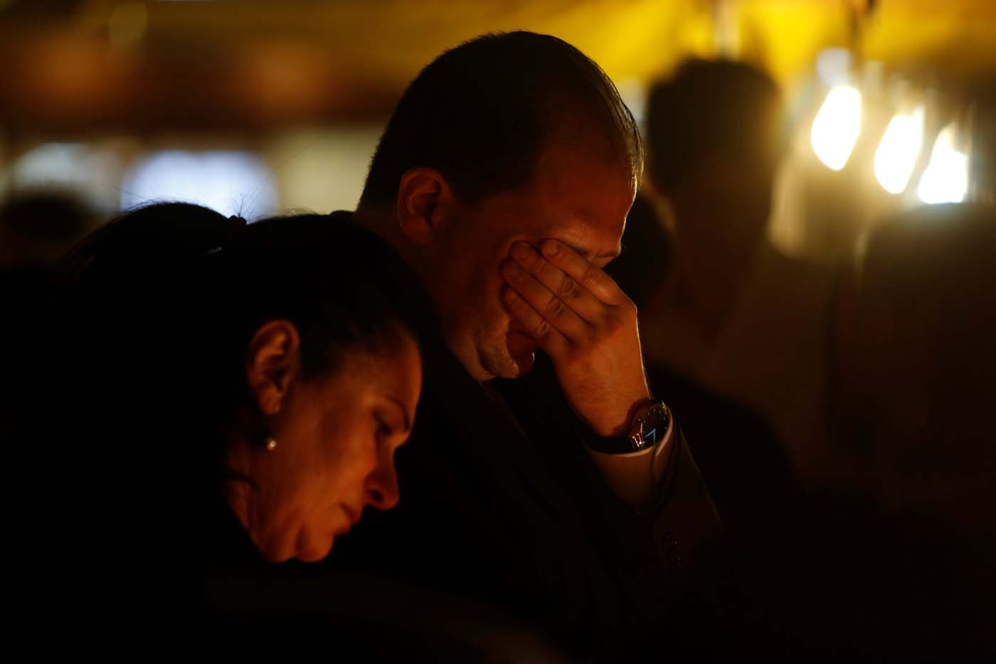 People react during a silent candlelight vigil to protest against the assassination of investigative journalist Daphne Caruana Galizia in a car bomb attack, in St Julian's, Malta, October 16, 2017. REUTERS/Darrin Zammit Lupi