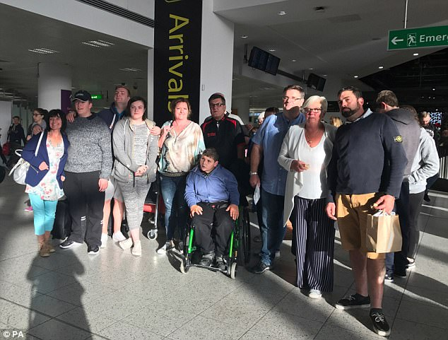 Builder Alan Jee, 42, from Bournemouth, has been saving 'for years' to pay for his £15,000 'love island' wedding with sweetheart Donna Smith, 40, and they were flying to Gran Canaria from Gatwick with 30 loved-ones today (pictured)