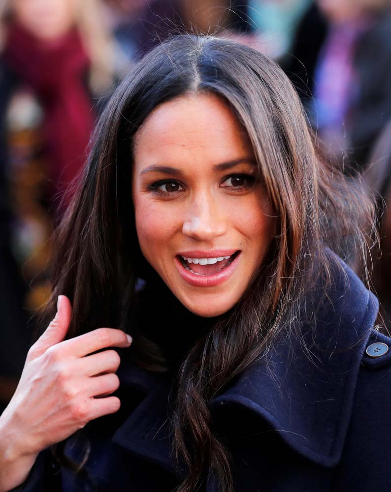 Meghan Markle greets well wishers as she arrives at an event with her fiancee Britain's Prince Harry in Nottingham, December 1, 2017. REUTERS/Eddie Keogh