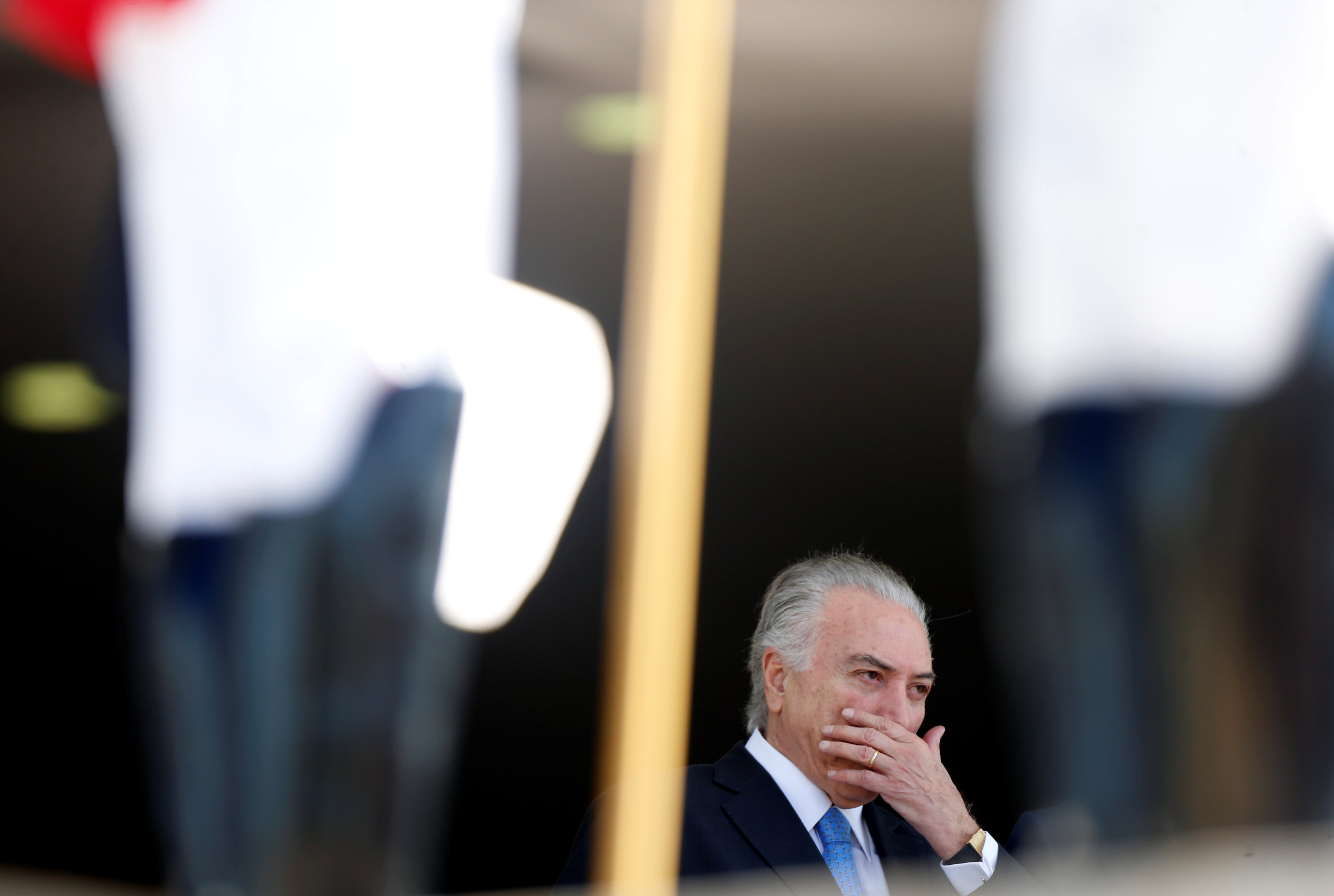Brazil's President Michel Temer gestures as he stands behind honour guard before welcoming his counterparts during Mercosur trade bloc annual summit in Brasilia, Brazil, December 21, 2017. REUTERS/Adriano Machado