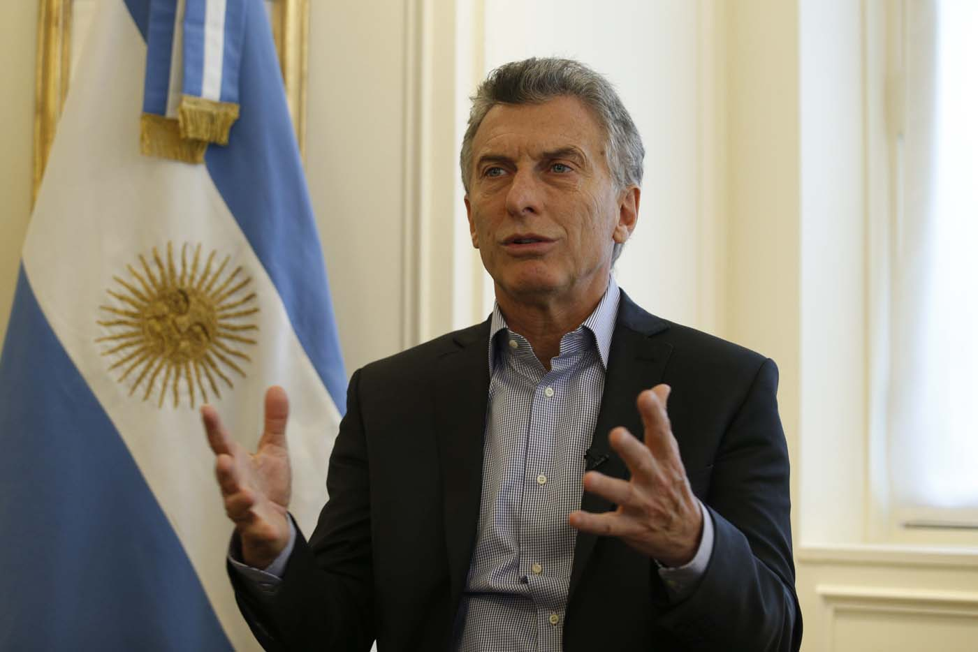Argentina's president Mauricio Macri speaks during an interview on January 27, 2018 at the Hotel La Tremoille in Paris.  / AFP PHOTO / GEOFFROY VAN DER HASSELT