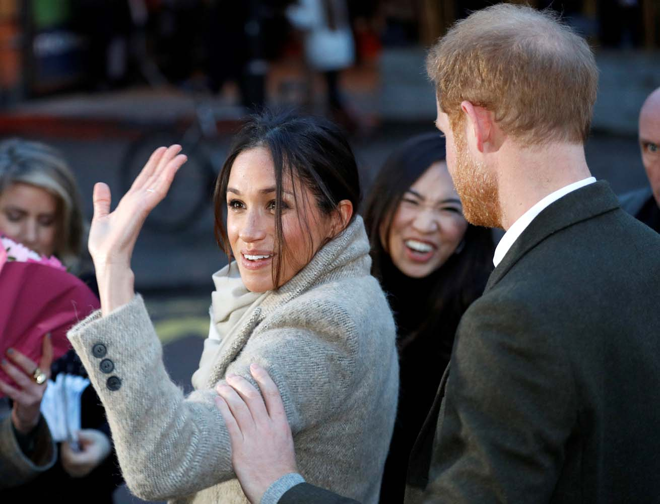 Britain's Prince Harry and his fiancee Meghan Markle greet well wishers as they leave after visiting radio station Reprezent FM, in Brixton, London January 9, 2018. REUTERS/Peter Nicholls