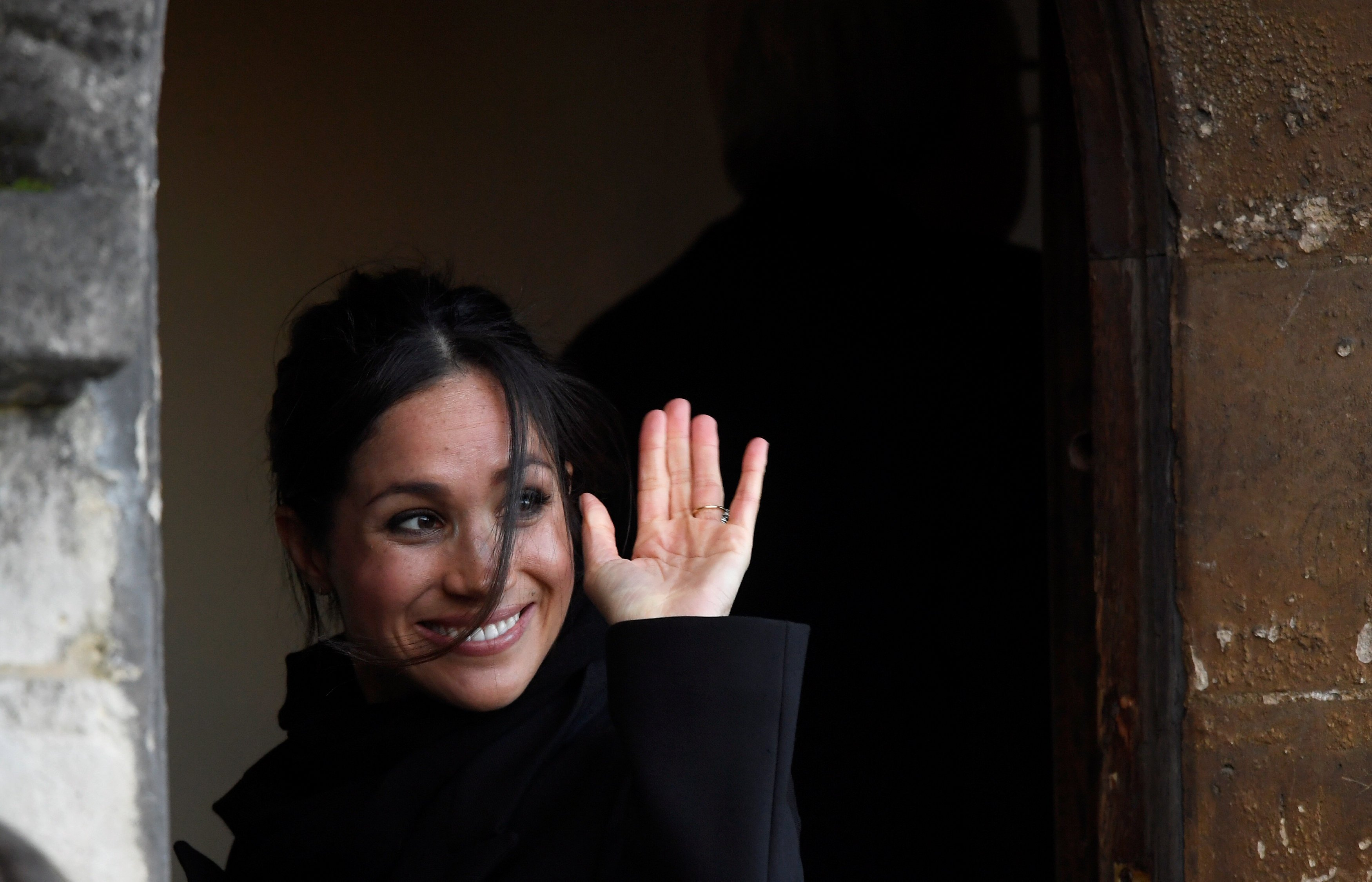 Meghan Markle greets well-wishers during a visit to Cardiff Castle with her fiancee Britain's Prince Harry in Cardiff, Britain, January 18, 2018. REUTERS/Toby Melville