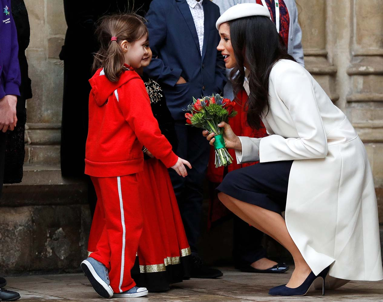 Britain's Prince Harry's fiancee Meghan Markle receives a bouquet of flowers after attending the Commonwealth Service at Westminster Abbey in London, Britain, March 12, 2018. REUTERS/Peter Nicholls