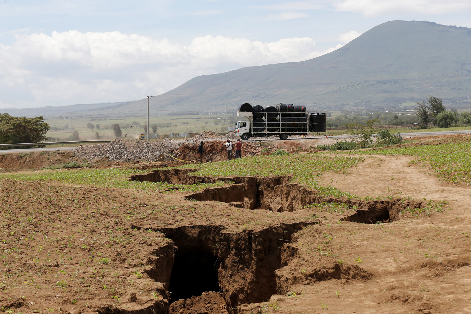 A truck drives near a chasm suspected to have been caused by a heavy downpour along an underground fault-line near the Rift Valley town of Mai Mahiu, Kenya March 28, 2018. Picture taken March 28, 2018. REUTERS/Thomas Mukoya