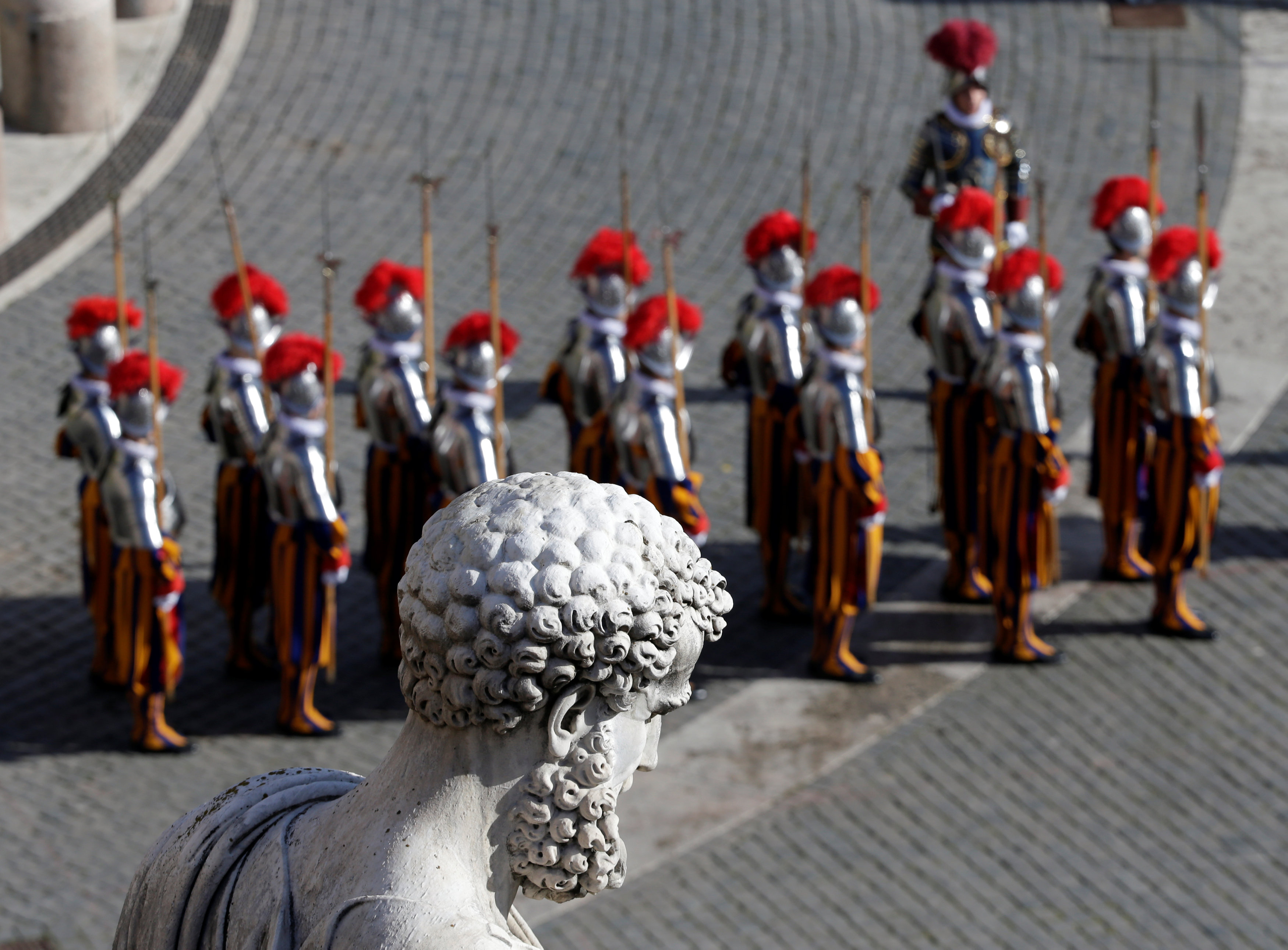 Swiss Guards stand in front of the St. Peter's Basilica before the Easter Mass at St. Peter's Square at the Vatican April 1, 2018. REUTERS/Max Rossi