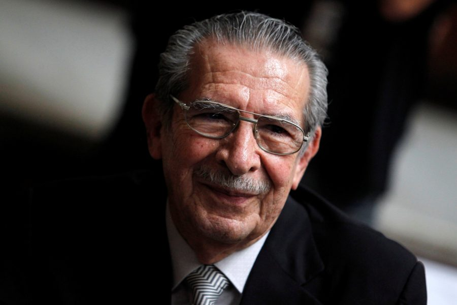 FILE PHOTO: Former Guatemalan dictator Efrain Rios Montt smiles during his genocide trial, which is drawing to a conclusion, at the Supreme Court of Justice in Guatemala City, Guatemala May 8, 2013. REUTERS/Jorge Dan Lopez/File Photo