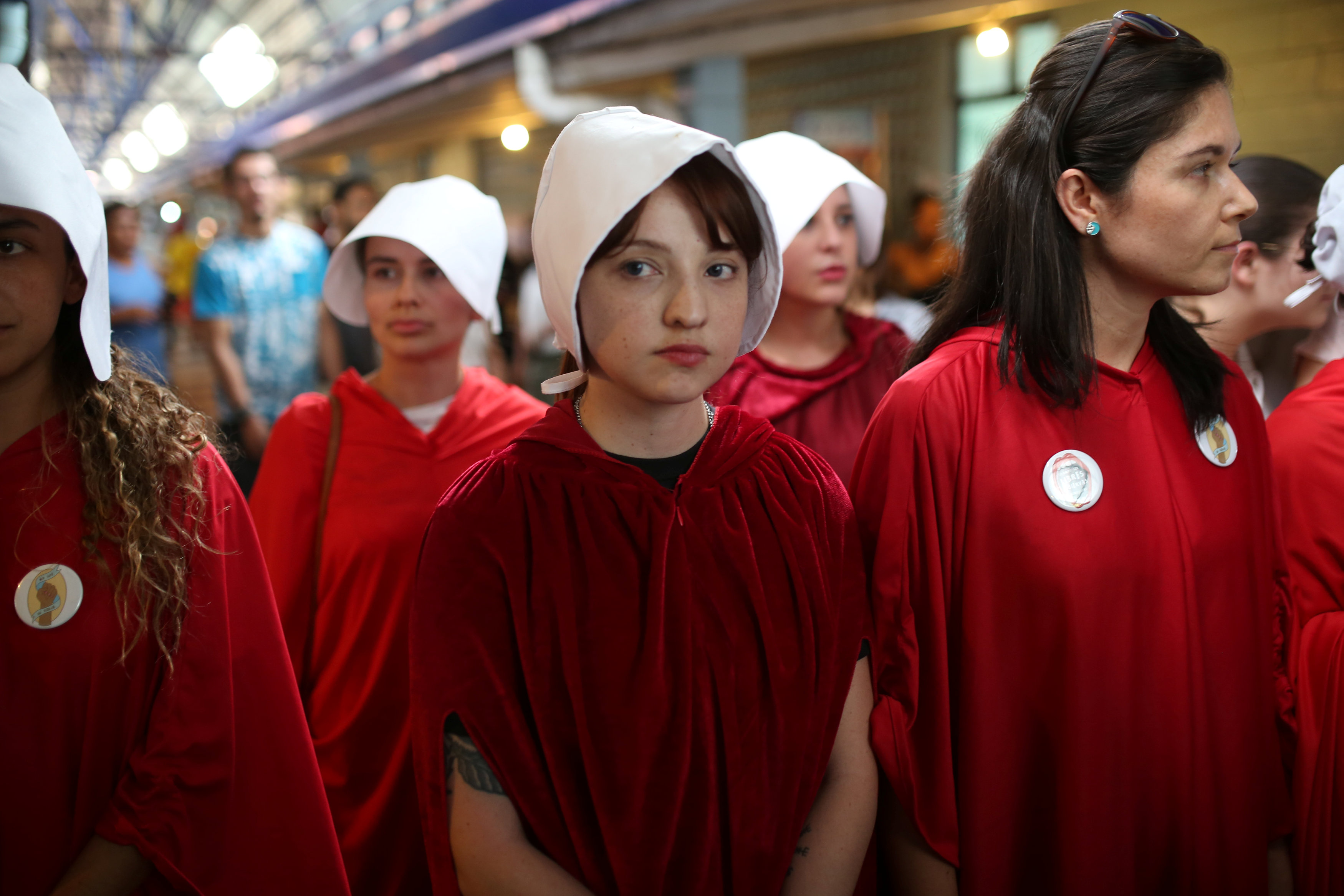 Activists dressed in costumes from The Handmaid's Tale series wait for the presidential candidate Carlos Alvarado Quesada at a polling station in San Jose, Costa Rica on April 1, 2018. REUTERS/Jose Cabezas