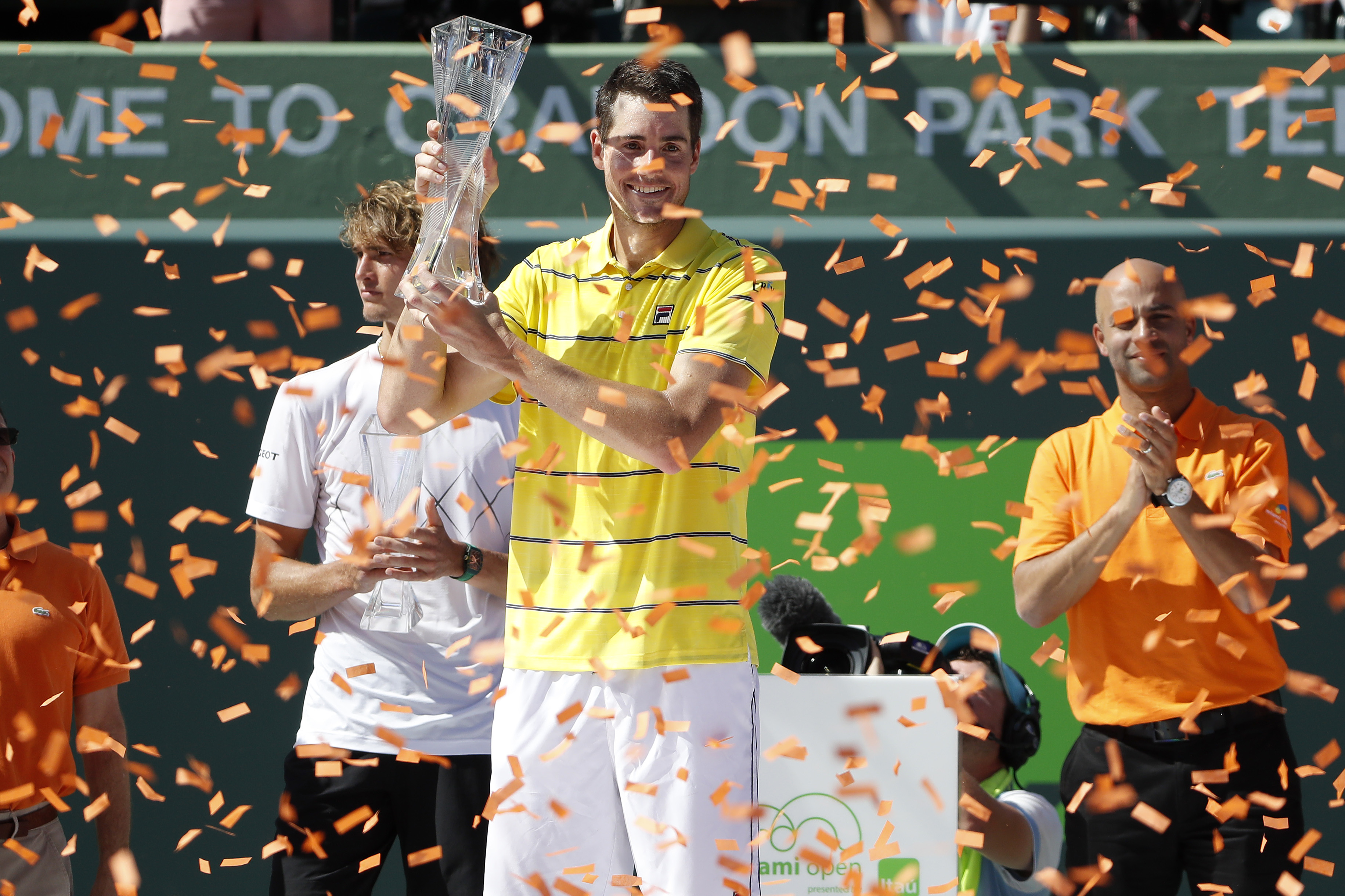 Apr 1, 2018; Key Biscayne, FL, USA; John Isner of the United States celebrates with the Butch Buchholz championship trophy after his match against Alexander Zverev of Germany (L) in the men's singles final of the Miami Open at Tennis Center at Crandon Park. 6-7(4), 6-4, 6-4. Mandatory Credit: Geoff Burke-USA TODAY Sports