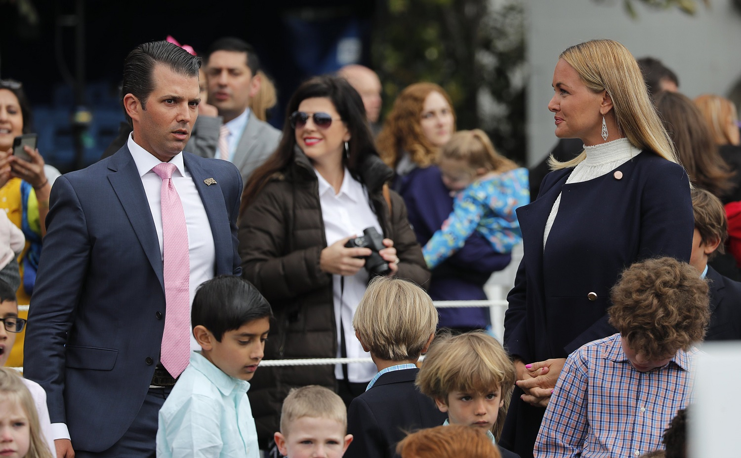 Donald Trump Jr stands near his estranged wife Vanessa, who recently filed for divorce, as they attend the annual White House Easter Egg Roll with their children on the South Lawn of the White House in Washington, U.S., April 2, 2018. REUTERS/Carlos Barria
