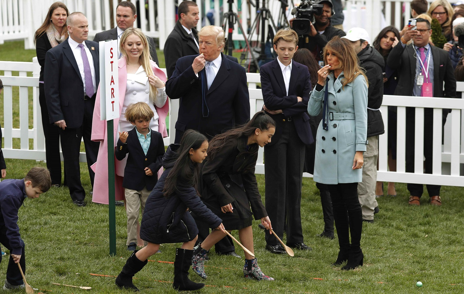 President Donald Trump and first lady Melania Trump blow whistles for children gathered for the annual White House Easter Egg Roll as they stand with his daughter Tiffany and their son Barron on the South Lawn of the White House in Washington, U.S., April 2, 2018. REUTERS/Carlos Barria