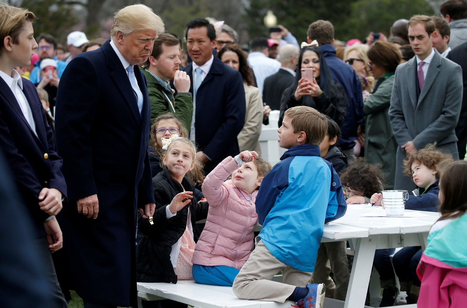 U.S. President Donald Trump greets children during the annual White House Easter Egg Roll on the South Lawn of the White House in Washington, April 2, 2018. REUTERS/Leah Millis