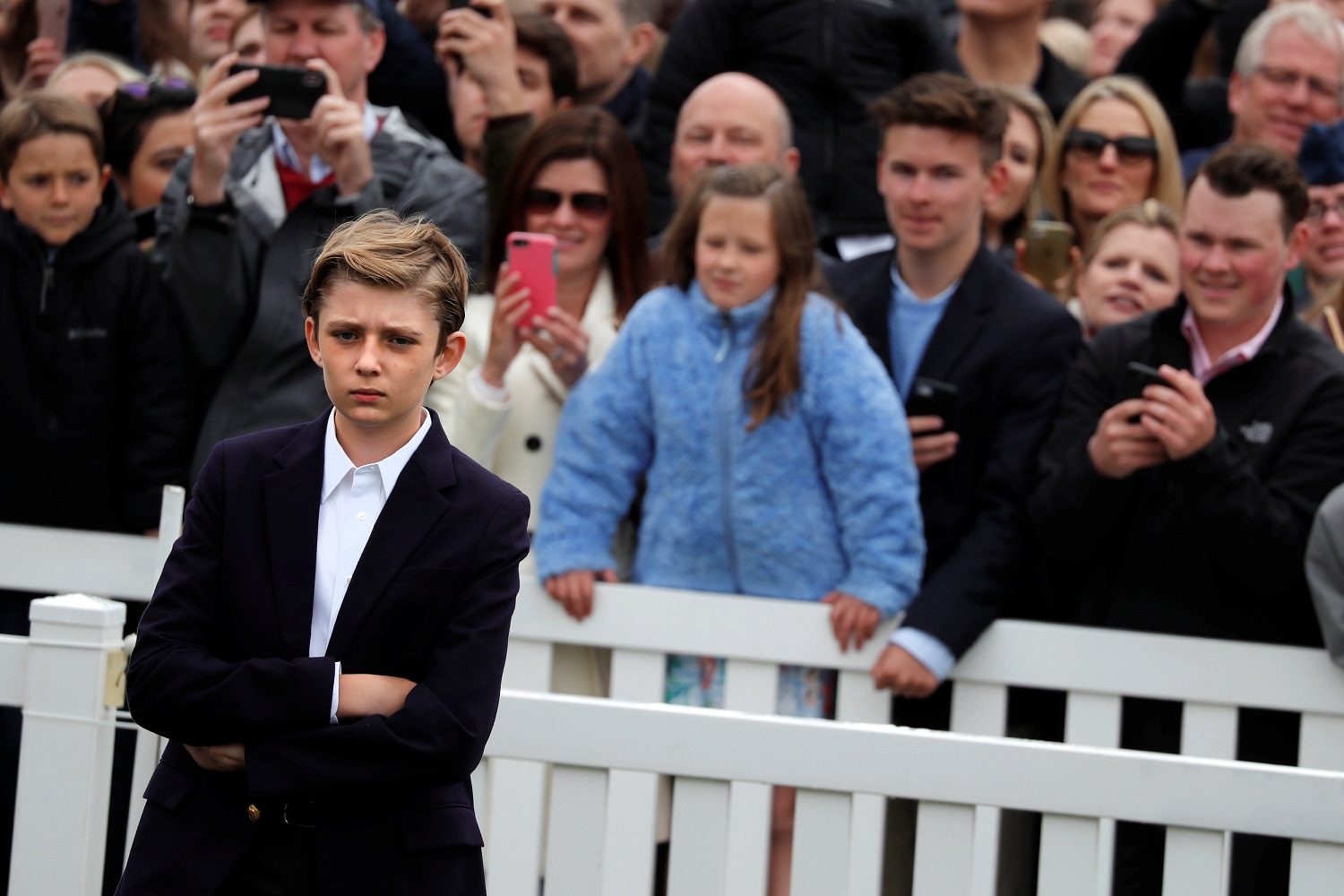 Barron Trump attends the annual White House Easter Egg Roll event on the South Lawn of the White House in Washington, U.S., April 2, 2018. REUTERS/Carlos Barria