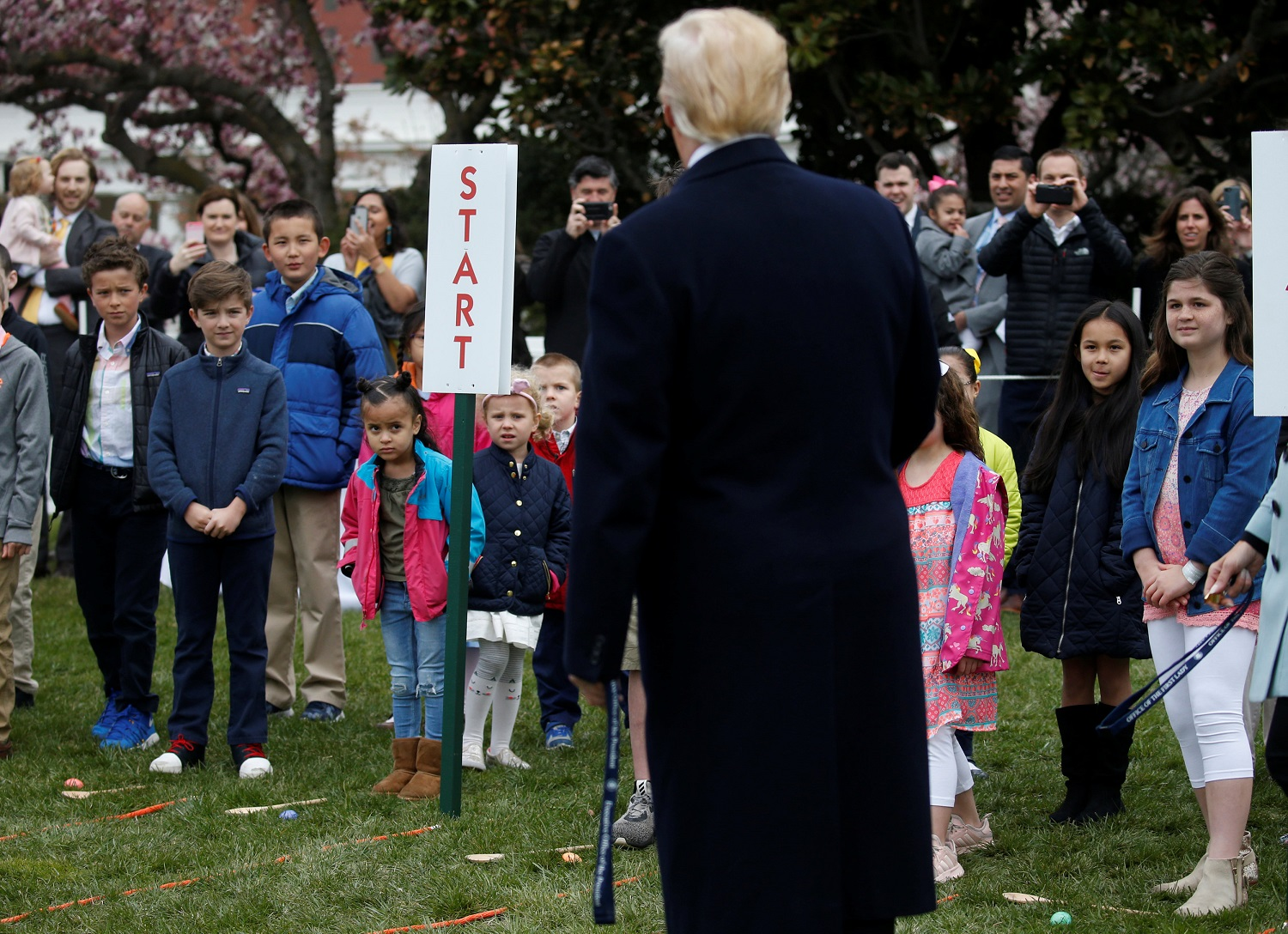 U.S. President Donald Trump greets children before blowing the whistle for their egg roll during the annual White House Easter Egg Roll on the South Lawn of the White House in Washington, April 2, 2018. REUTERS/Leah Millis