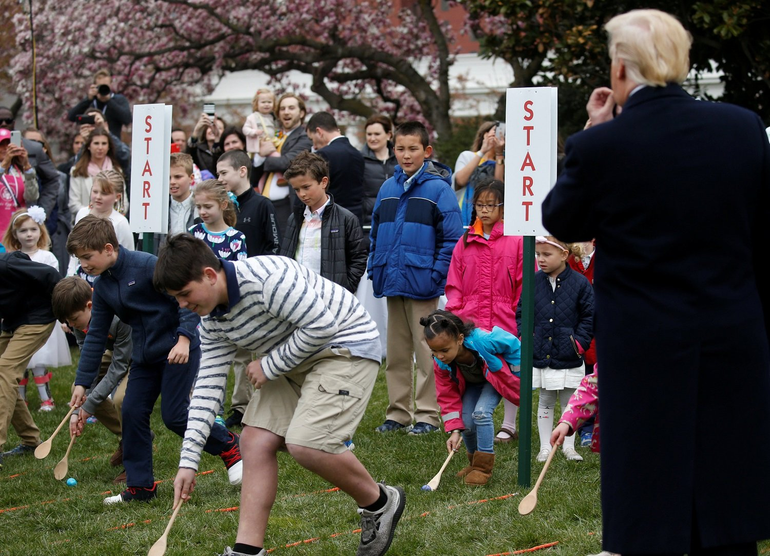 U.S. President Donald Trump blows the whistle to start an egg roll during the annual White House Easter Egg Roll on the South Lawn of the White House in Washington, April 2, 2018. REUTERS/Leah Millis