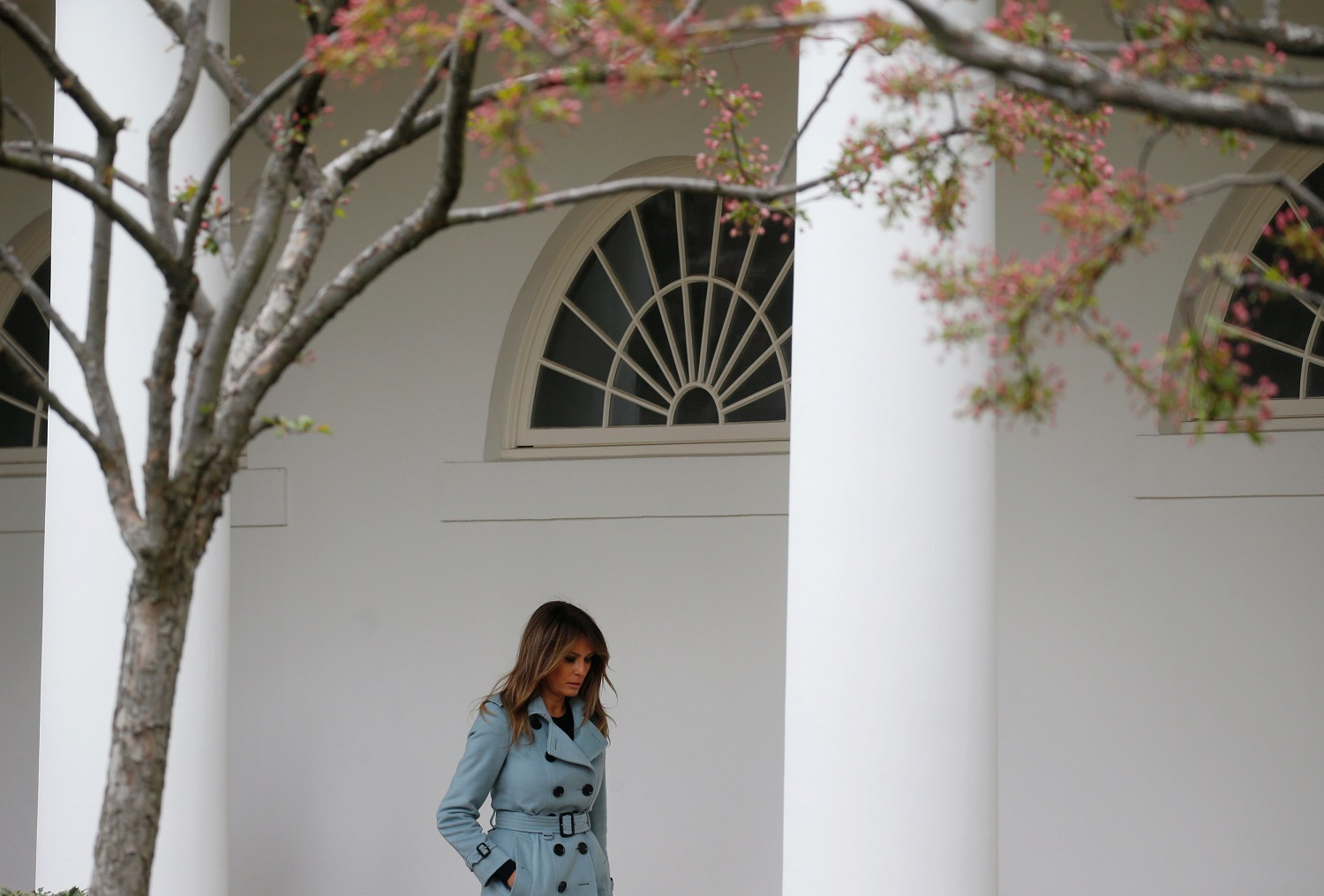 First lady Melania Trump walks by the rose garden after attending the annual White House Easter Egg Roll on the South Lawn of the White House in Washington, April 2, 2018. REUTERS/Leah Millis