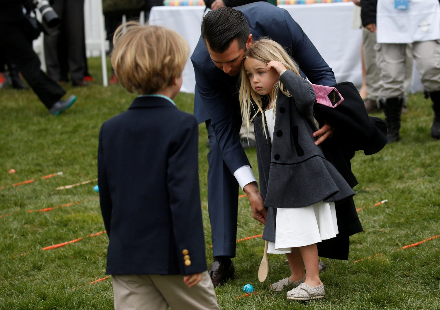 Donald Trump Jr. helps his daughter Chloe Trump participate in the egg roll during the annual White House Easter Egg Roll on the South Lawn of the White House in Washington, April 2, 2018. REUTERS/Leah Millis
