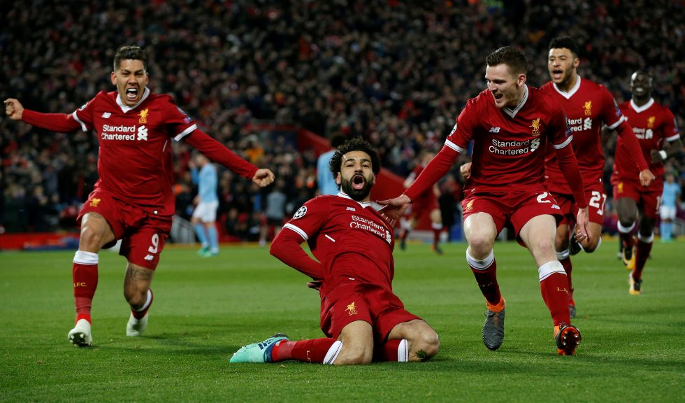 Soccer Football - Champions League Quarter Final First Leg - Liverpool vs Manchester City - Anfield, Liverpool, Britain - April 4, 2018   Liverpool's Mohamed Salah celebrates with Roberto Firmino and Andrew Robertson after scoring their first goal    REUTERS/Andrew Yates     TPX IMAGES OF THE DAY
