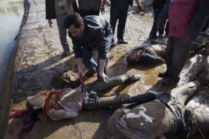 Macabro descubrimiento de cuerpos en Siria (Fotos fuertes)