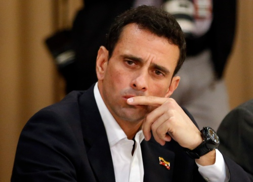 Opposition leader and Governor of Miranda state Henrique Capriles attends a meeting with representatives of the opposition, the Roman Catholic Church and the UNASUR in Caracas