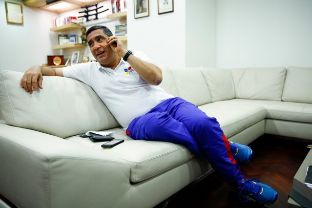 Venezuela's Interior Minister Rodriguez talks on his mobile phone during an interview with Reuters in Caracas