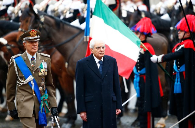 Italy's new President Sergio Mattarella inspects a guard of honour during a welcoming ceremony at the Quirinale presidential palace in Rome