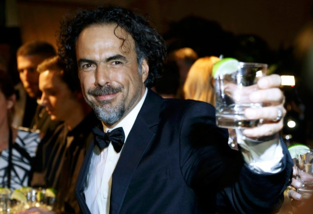 Director Alejandro Gonzalez Inarritu toasts after winning the Oscar for best picture, best director and best original screenplay at the Governors Ball after the 87th Academy Awards in Hollywood