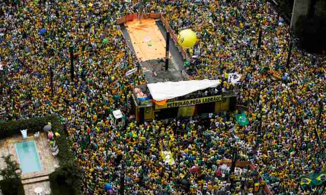 Demonstrators gather during a protest against Brazil's President Dilma Rousseff at Paulista avenue in Sao Paulo