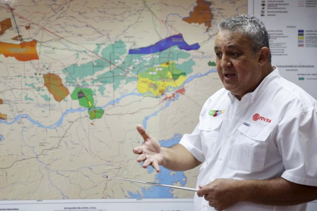 The president of Venezuelan state oil company PDVSA, Eulogio Del Pino, speaks in front of a map of the oil rich Orinoco belt, during a meeting with the press in Morichal at the state of Monagas