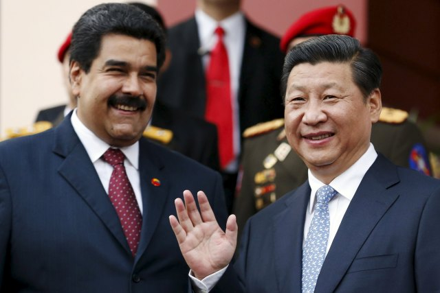 File photo of China's President Xi attending meeting with Venezuela's President Nicolas Maduro at Miraflores Palace in Caracas