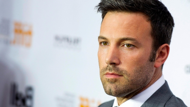 """FILE - This Sept. 7, 2012 file photo shows actor and director Ben Affleck poseing for a photograph on the red carpet at the gala for the new movie """"Argo"""" during the 37th annual Toronto International Film Festival in Toronto. Affleck is comparing US Republican presidential candidate Mitt Romney to past presidential hopefuls Al Gore, Michael Dukakis and Bob Dole.  But the actor and director, who has been outspoken in support of Democratic causes in the past, also doesn't offer full-throated support for President Barack Obama.  (AP Photo/The Canadian Press, Nathan Denette)"""