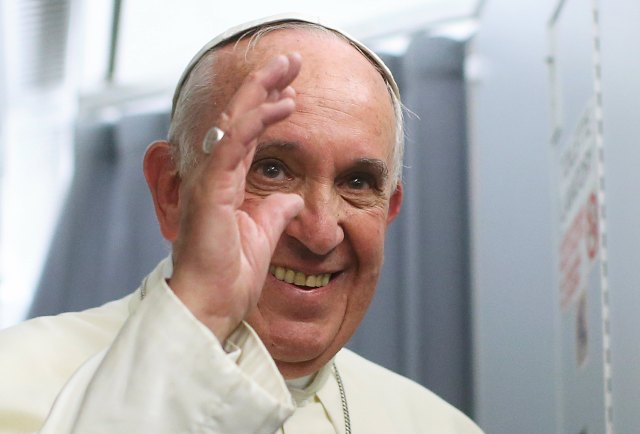 Pope Francis smiles onboard the papal plane during his return to Rome, from Asuncion, Paraguay