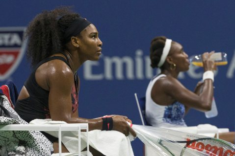 Serena Williams of the U.S. and her sister and compatriot Venus Williams rest between games during their quarterfinals match at the U.S. Open Championships tennis tournament in New York