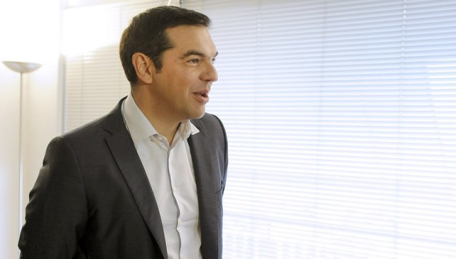 Leftist Syriza party leader and winner of the Greek general election Alexis Tsipras is seen before a meeting with leader of right-wing Independent Greeks party Panos Kammenos (not pictured), at his office at the party's headquarters in Athens, Greece, September 21, 2015. Greece's Independent Greeks party said on Sunday it would ally with election winners Syriza to form a coalition government. REUTERS/Michalis Karagiannis