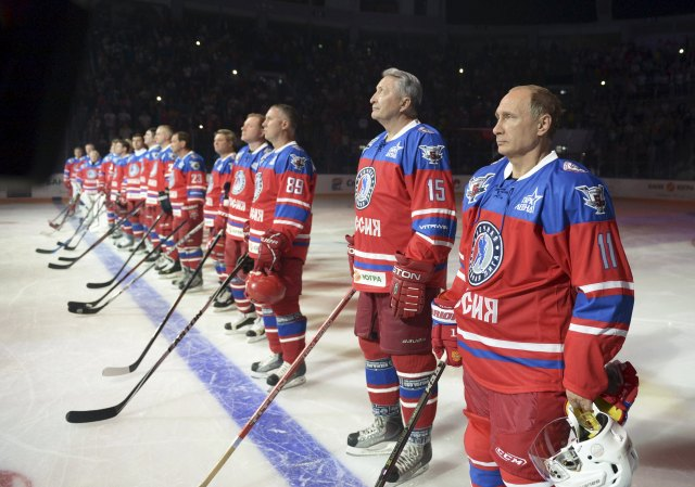 Putin takes part in a ceremony before a gala game opening a new season of the Night Ice Hockey League in Sochi
