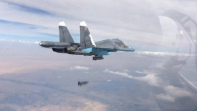 Frame grab shows Russian fighter-bomber droping bomb in air over Syria