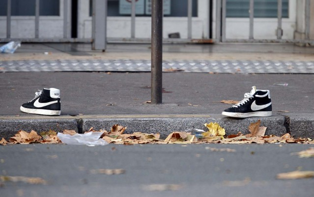 A pair of abandoned shoes seen left in the street near the Bataclan concert hall the morning after a series of deadly attacks in Paris, in this November 14, 2015 file photo.      REUTERS/Charles Platiau/Files