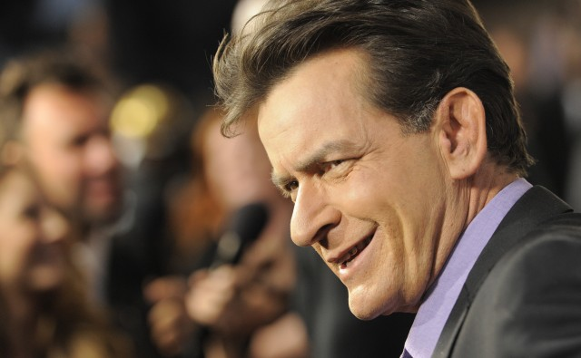 """Charlie Sheen, a cast member in """"Scary Movie V,"""" is interviewed at the Los Angeles premiere of the film at the Cinerama Dome on Thursday, April 11, 2013 in Los Angeles. (Photo by Chris Pizzello/Invision/AP)"""